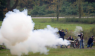 Members of the 124th New York State Volunteers fire a cannon at a Confederate position during a Civil War reenactment at the Orange County Farmers Museum on Sept. 23, 2006.