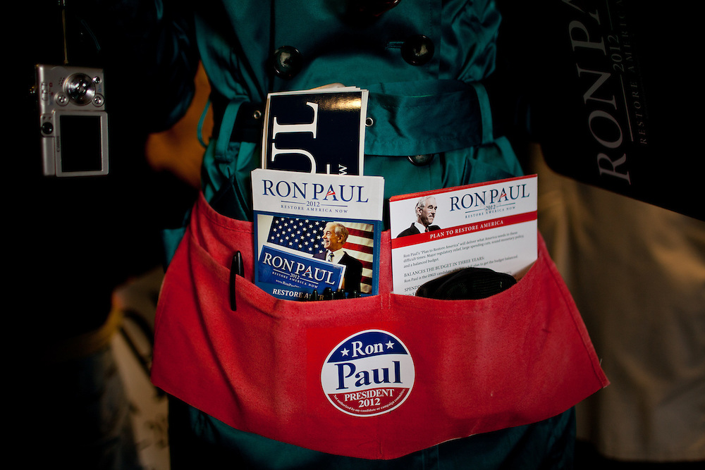 Sherry Rose a volunteer for GOP presidential candidate Rep. Ron Paul, has her campaign brochures well-organized at a campaign rally in Boise, Idaho, February 18, 2012.