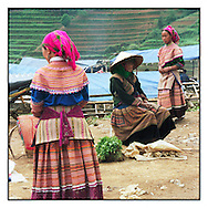 Hmong flower women wearing beautiful ethnic dress in Can Cau market, Bac Ha, Vietnam, Asia