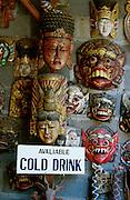 Masks and cold drinks at Tenganan, showcase village of the Bali Aga tribe.