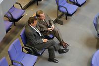 18 JUN 2003, BERLIN/GERMANY:<br /> Gerhard Schroeder (L), SPD, Bundeskanzler, und Franz Muentefering (R), SPD fraktionsvorsitzender, im Gespraech, waehrend der Bundestagsdebatte zur Beteiligung der Bundeswehr am EU-gefuehrten Einsatz im Kongo, Plenum, Deutscher Bundestag<br /> IMAGE: 20030618-01-076<br /> KEYWORDS: Debatte, Gerhard Schröder, Gespräch, Franz Müntefering
