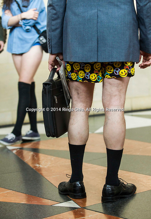 Participants in the13th annual International 'No Pants Subway Ride' at Union Station on January 12, 2014,  in Los Angeles, California. 'No Pants Subway Ride' is an annual event in which transit passengers ride trains without wearing pants in January. The event is observed in dozens of cities worldwide. (Photo by Ringo Chiu/PHOTOFORMULA.com)