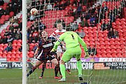 Blackpool defender Tom Aldred (15) clears the ball during the Sky Bet League 1 match between Doncaster Rovers and Blackpool at the Keepmoat Stadium, Doncaster, England on 28 March 2016. Photo by Simon Davies.