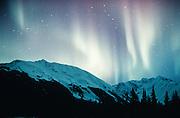 Alaska.  Eerie glow of Northern Lights (Aurora Borealis)