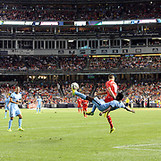 Kelechi Iheanacho, Manchester City, tries a spectacular overhead kick during the Manchester City Vs Liverpool FC Guinness International Champions Cup match at Yankee Stadium, The Bronx, New York, USA. 30th July 2014. Photo Tim Clayton