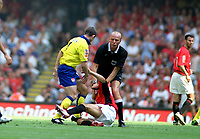 Jeffers Sending off incident. Francis Jeffers (Arsenal) kicks Phil Neville on the ground as Referee Mr.Steve Bennett moves in to seperate them. Manchester United v Arsenal. Community Shield.10/8/03. Millennium Stadium. Credit : Colorsport/Andrew Cowie.
