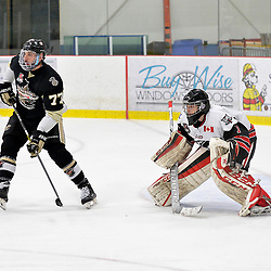 GEORGETOWN, ON  - APR 18,  2017: Ontario Junior Hockey League, Championship Series.  Georgetown Raiders vs the Trenton Golden Hawks in Game 3 of the Buckland Cup Final.  Anthony Sorrentino #77 of the Trenton Golden Hawks sets up in front of goaltender Josh Astorino #1 of the Georgetown Raiders during the second period.<br /> (Photo by Shawn Muir / OJHL Images)