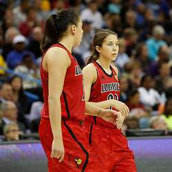 Apr 9, 2013; New Orleans, LA, USA; Louisville Cardinals guard Jude Schimmel (right) and guard Shoni Schimmel (left) talk against the Connecticut Huskies during the second half of the championship game in the 2013 NCAA womens Final Four at the New Orleans Arena. Mandatory Credit: Derick E. Hingle-USA TODAY Sports