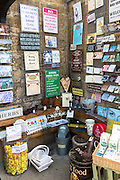 Quirky and jokey gifts and souvenirs signs and ephemera at gift shop in Burford, The Cotswolds, Oxfordshire, UK
