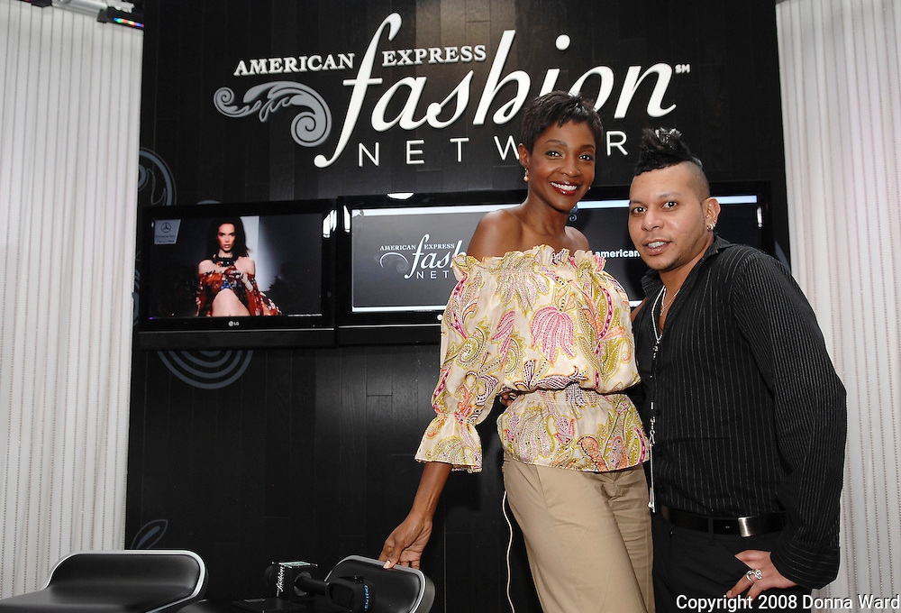 Model Roshumba and make-up artist Carlos Sanchez pose at the American Express Fashion Network booth