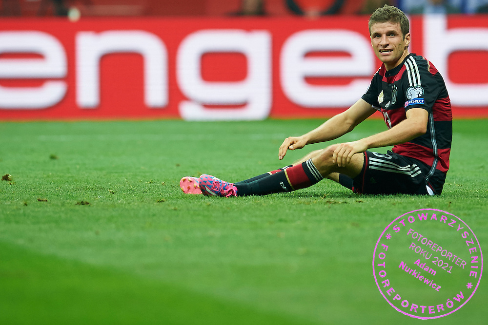 German's Thomas Muller sits on th pitch during the EURO 2016 qualifying match between Poland and Germany on October 11, 2014 at the National stadium in Warsaw, Poland<br /> <br /> Picture also available in RAW (NEF) or TIFF format on special request.<br /> <br /> For editorial use only. Any commercial or promotional use requires permission.<br /> <br /> Mandatory credit:<br /> Photo by &copy; Adam Nurkiewicz / Mediasport