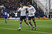 Preston North End Defender Calum Woods and Preston North End Midfielder Adam Reach celebrate during the Sky Bet Championship match between Preston North End and Brentford at Deepdale, Preston, England on 23 January 2016. Photo by Pete Burns.