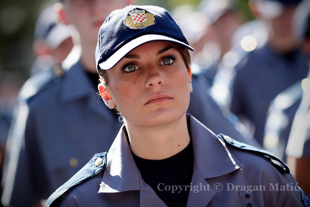 Police woman cadet at ceremony celebrating opening of the new police school.