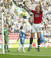 Photo: Aidan Ellis.<br /> Wigan Athletic v Manchester United. The Barclays Premiership. 14/10/2006.<br /> United's Nemanja Vidic celebrates his goal