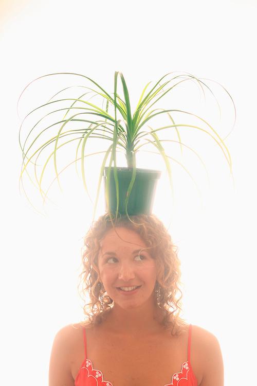 Sasha B. holds a plant
