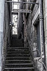 View along traditional Anchor Close in Edinburgh Old Town Scotland, United Kingdom