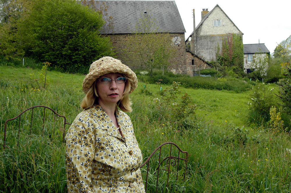 For a story by Matt Saltmarsh on Brits leaving their French country homes...France, Saint-Siméon, approximately 250 kms. southwest of Paris, Patricia Mansfield-Devine, 46, a freelance writer, in the garden of her French home. May 8, 2009...Photo © J.B. Russell for the International Herald Tribune