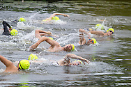 Monroe, New York - People start the 1/3-mile swim at Twin Lakes Water Ski Park in the third annual Southern Orange Family YMCA Tri/Duathlon & Run/Walk on Aug. 2, 2014.