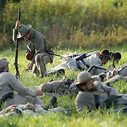 Confederate soldiers, pretending to be injured or dead, lay on the battle field during a sunrise reenactment of Donelson's Attack, part of a weekend of events commemorating the 150th anniversary of the Battle of Perryville in Perryville, Ky. Saturday October 6, 2012.  Photo by David Stephenson