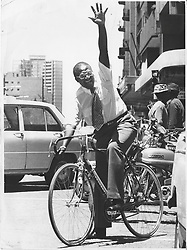 19.11.1975<br /> The very Rev Desmond Tutu, Johannesburg Dean Waves at pedestrians as he tries out the sleek racing Bike he is to raffle to raise funds for new hall. Dean Tutu hopes to build a hall In StMary's Cathedral for multiracial functions the planned Hall could cost R100 000.The bike, donated by Mr. Michael Carricaburu of Peugeot Cycles is Worth about R100 Concerned about city<br /> Office workers Dean Tutu will also open The Cathedral Garden and courtyard to the Public during their lunch hour<br /> Picture: The Star ( Independent Newspapers )