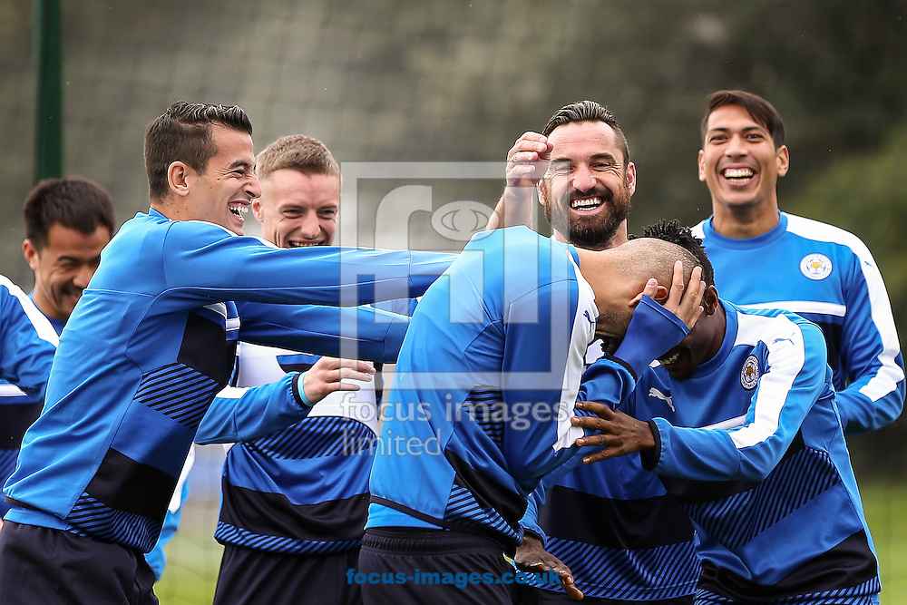 Islam Slimani of Leicester City (centre) is ribbed by his team mates during the Leicester City training session at Leicester City Training Ground, Leicester<br /> Picture by Andy Kearns/Focus Images Ltd 0781 864 4264<br /> 26/09/2016