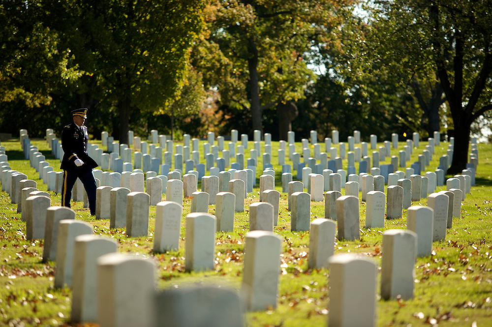 "Around each funeral at Arlington you will see three to four soliders in their dress blue uniform guarding the ceremony from a distance of 100 or more yards away. They are called ""Supers."" They position themselves near roads or in the open to prevent others from accidentally intruding on the ceremony."