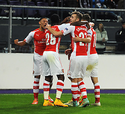 Arsenal's Lukas Podolski celebrates with his team mates after scoring the winning goal - Photo mandatory by-line: Dougie Allward/JMP - Mobile: 07966 386802 - 22/10/2014 - SPORT - Football - Anderlecht - Constant Vanden Stockstadion - R.S.C. Anderlecht v Arsenal - UEFA Champions League - Group D