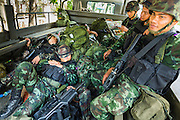"20 MAY 2104 - BANGKOK, THAILAND: Thai soldiers sleep in the back of a truck on Ratchadamri Road in Bangkok after the army put soldiers on the street following the declaration of martial law. The Thai Army declared martial law throughout Thailand in response to growing political tensions between anti-government protests led by Suthep Thaugsuban and pro-government protests led by the ""Red Shirts"" who support ousted Prime Minister Yingluck Shinawatra. Despite the declaration of martial law, daily life went on in Bangkok in a normal fashion. There were small isolated protests against martial law, which some Thais called a coup, but there was no violence.   PHOTO BY JACK KURTZ"