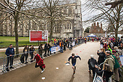 UNITED KINGDOM, Winchester: 05 March 2019 Winchester Pancake Race Photo Feature:<br /> A member of the Winchester Cathedral Choir (left) races his opponent of St Bede School at the Inaugural Winchester Pancake Race earlier this afternoon on Shrove Tuesday. The race, which consisted of 20 teams, took place in the gardens surrounding Winchester Cathedral. <br /> Rick Findler / Story Picture Agency