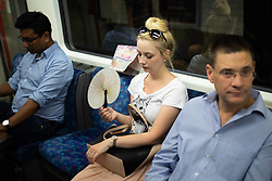© Licensed to London News Pictures. 26/07/2018. London, UK. Passengers travel on the London Underground during hot weather. Today is predicted to be the hottest day of the year, with temperatures in the capital set to rise up to 35 degrees, as the UK experiences a prolonged heatwave. Photo credit : Tom Nicholson/LNP