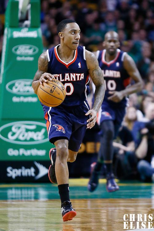 29 March 2013: Atlanta Hawks point guard Jeff Teague (0) brings the ball upcourt during the Boston Celtics 118-107 victory over the Atlanta Hawks at the TD Garden, Boston, Massachusetts, USA.