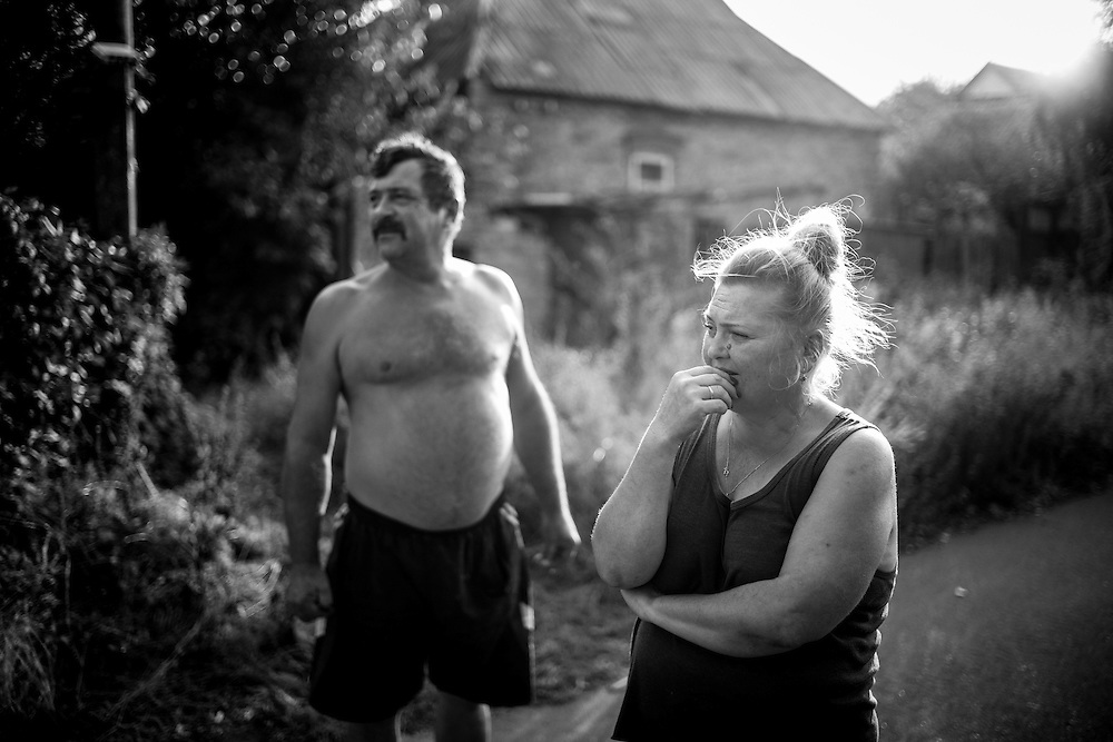 """Oksana and her husband are some of the very few still living in the area closest to the frontline. Most of the houses have been hit, directly or indirectly, by the shells. """"At night, when the fighting is at its most intense, we take cover in our basement. We don't come out until dawn and the shelling stops"""", says Oksana."""