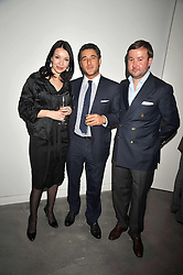 Left to right, Orel gallery owner ILONA OREL, LUCA DEL BONO and TIMBERBULAT KARIMOV at a private view of Liquid Modernity - aworks by artist Andrei Molodkin held at Orel Art UK, 7 Howick Place, London on 22nd April 2009.