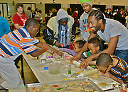 African Americans children prepare cookies for baking at Cape May art and cookie holiday event. Family activities Children, Foods,