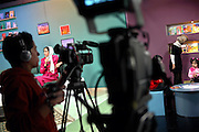 Azita Arif Nazimi, 25, (left) is presenting 'Family Live Show', a television program broadcasted live by Channel 1, an Afghan national television, in Kabul, Afghanistan.