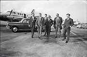 25/06/1965<br /> 06/25/1965<br /> 25 June 1965<br /> Arrival of Dr Carl H. Hahn of Volkswagen at Dublin Airport.<br /> Dr. Hahn, Sales and Service Director, Volkswagenwerke, A.G., Germany, arrived in Ireland on the company plane. He was President of Volkswagen of America. He had recently returned to Wolfsburg and was visiting Ireland as part of a brief European tour to familiarise himself with local conditions. Image shows Dr Hahn (2nd from left. in front of his Beechcraft Kingaire being greeted by Mr. Stephen O'Flaherty (4th from left); Mr. Michael P. O'Flaherty (on left), Chairman Volkswagen Distributers Ltd. and Mr. Dermod Ryan, General Manager Volkswagen Distributers Ltd. (on right?). Also present were Mr. E. Schneider and Mr. U. (?) P. Kiesewetter, Factory Delegates for North West Europe. Car appears to be a Volkswagen Type 3.