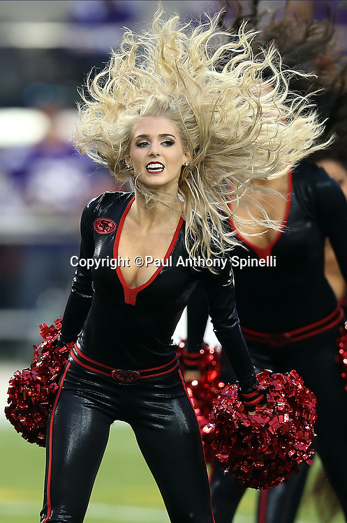 The San Francisco 49ers cheerleaders flip their hair during a pregame dance routine before the 2015 NFL week 1 regular season football game against the Minnesota Vikings on Monday, Sept. 14, 2015 in Santa Clara, Calif. The 49ers won the game 20-3. (©Paul Anthony Spinelli)