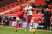 Charlton Athletic Midfielder Mark Marshall (7) and Bradford City Defender Stephen Warnock (15) battle for the ball during the EFL Sky Bet League 1 match between Charlton Athletic and Bradford City at The Valley, London, England on 13 February 2018. Picture by Stephen Wright.