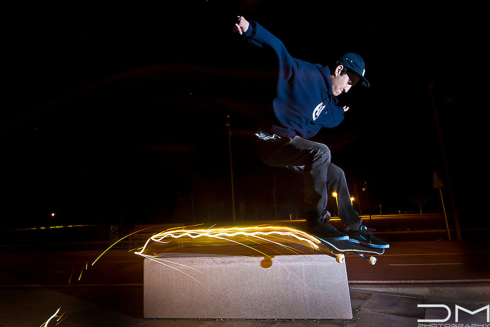 Skateboarding in Spain with a sparkler atached to the board.
