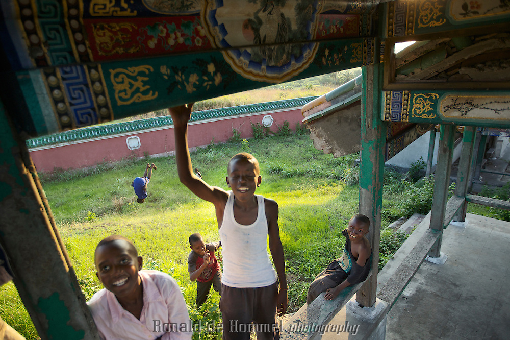 Children come to play in the deserted Chinese palace of former dictator Mobutu in Nsele, north of the capital Kinshasa. ..More and more Congolese feel a certain nostalgia to the times of the notorious dictator Mobutu. Rampant poverty, economic exploitation by foreign powers and an unwinnable civil war in the east of the country undermine the popularity of the current president Kabila. The old times with their strong leader that received respect from former colonizing power France and the rest of the Western world pose a certain attraction. ..