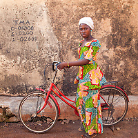 Young Girl from Tamale, Ghana Standing with her Classic Vintage Bicycle