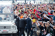 Pope Francis waves to the faithful as he arrives for his weekly general audience in st. peter's square at the Vatican on May 09, 2018