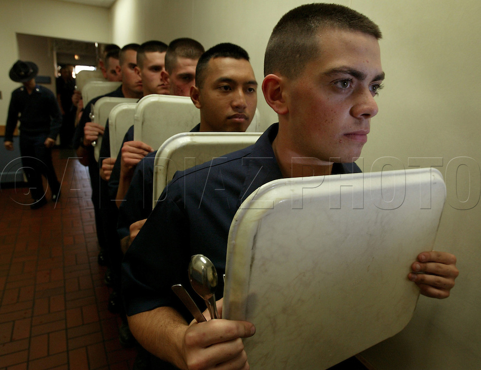Seaman recruits wait in line during boot camp at The United States Coast Guard Training Center, Cape May, NJ.