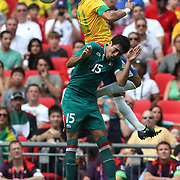 Neymar, Brazil, wins a header from Nestor Vidrio, Mexico, during the Brazil V Mexico Gold Medal Men's Football match at Wembley Stadium during the London 2012 Olympic games. London, UK. 11th August 2012. Photo Tim Clayton
