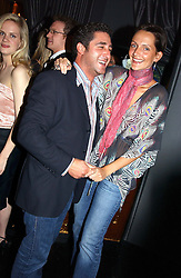 LUCA DEL BONO and model SAFFRON ALDRIDGE at Tatler Magazine's Summer Party held at the Baglioni Hotel, 60 Hyde Park Gate, London SW7 on 1st July 2004.