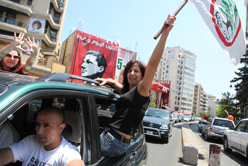 "Lebanese went to the polls on 7 June 2009 to elect a new government to run the country for the next four years. The vote is crucial as it puts the governming ""March 14"" coalition against a powerful opposition that includes the resistance and political movement Hizballah. Although Hizballah is all but guaranteed 11 out of the 128 parliamentary seats, the elections are being framed as a victory for Hizballah if the opposition does take the majority of seats. The real battle is being fought between the country's Christian communities. Former Lebanese General Michel Aoun's Free Patriotic Movement is challenging the Christian parties of the March 14 alliance. Lebanon's political system is split 50/50 between Muslims an Christians even though Muslims represent an overwhelming majority of the population. ///A supporter of the Lebanese Forces party, which is allied with the governing pro-Western ""March 14 alliance celebrates in Beirut's Ashrafiyeh neighborhood. Ashrafiyeh is an important battleground between the competing parties of the governing ""March 14"" alliance and the ""Change and Reform Bloc"" opposition."