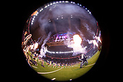 Smoke and fire fill the air as the Dallas Cowboys shown on the jumbotron screen hanging over the field players are introduced during pregame in this wide angle, 360 degree circular photograph taken before the Dallas Cowboys NFL week 13 regular season football game against the New Orleans Saints on Thursday, Nov. 29, 2018 in Arlington, Tex. The Cowboys won the game 13-10. (©Paul Anthony Spinelli)