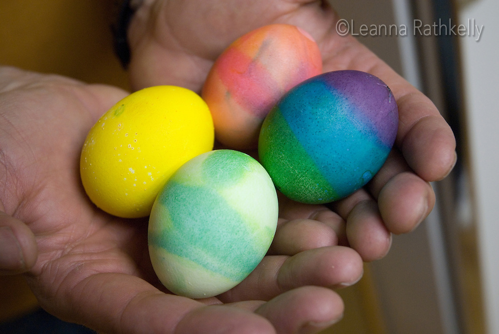 Painted Easter eggs in hands hands hold painted Easter eggs