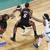 03 June 2012: Miami Heat point guard Mario Chalmers (15) faces Boston Celtics shooting guard Marquis Daniels (4) as he drives past Boston Celtics point guard Keyon Dooling (51) on a screen set by Miami Heat small forward LeBron James (6) during the Boston Celtics 93-91 overtime victory over the Miami Heat, in Game 4 of the Eastern Conference Finals playoff series, at the TD Banknorth Garden, Boston, Massachusetts, USA.