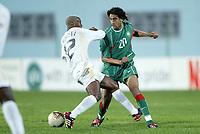 Fotball<br /> African Nations Cup 2004<br /> Afrika Mesterskapet<br /> Foto: Digitalsport<br /> Norway Only<br /> <br /> FIRST ROUND - GROUP D - 040204<br /> MOROCCO v SOUTH AFRICA<br /> MAROKKO v SØR AFRIKA<br /> <br /> YOUSSOUF HADJI (MOR) / TEBEHO MOKOENA (RSA)